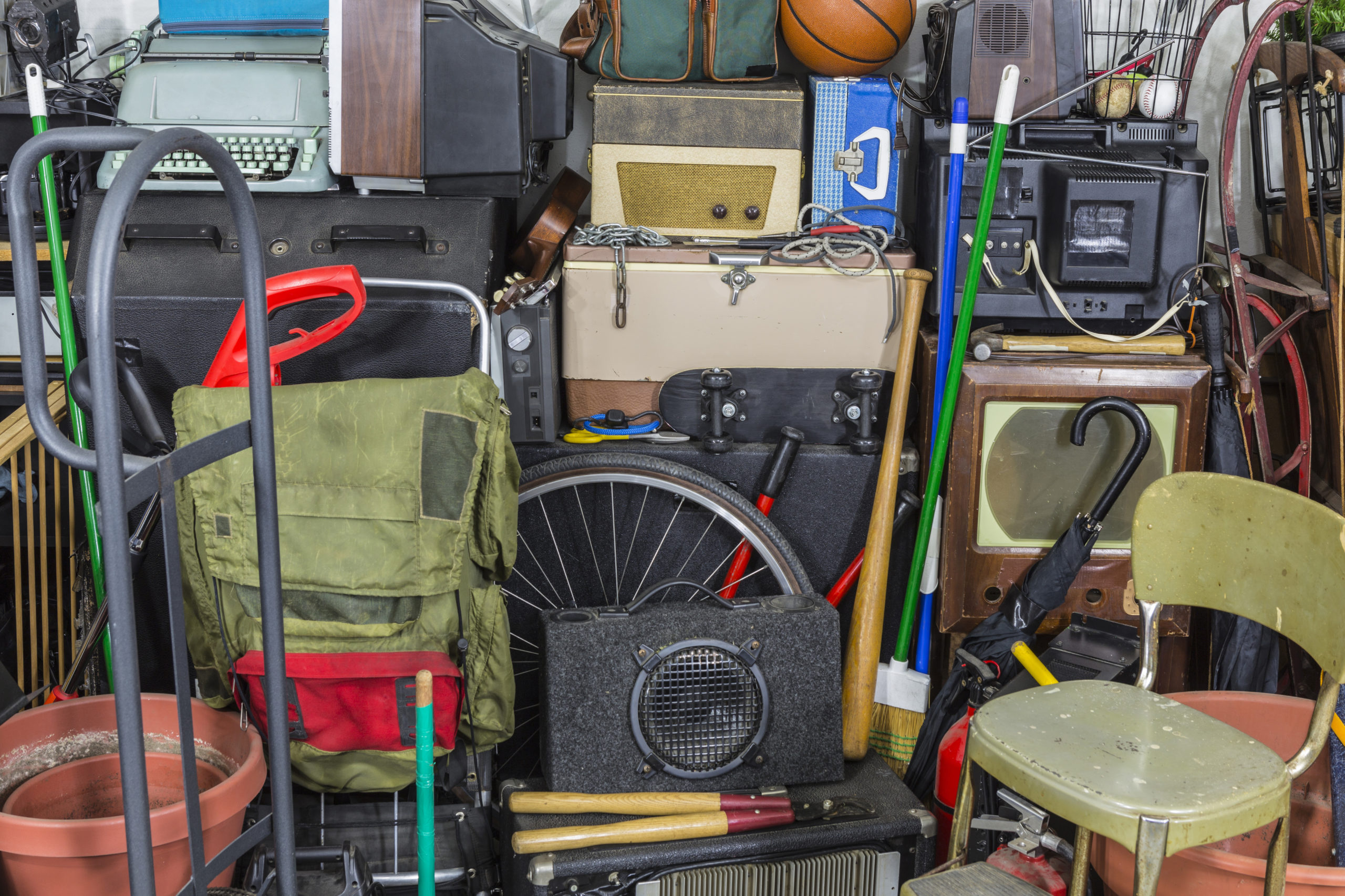 Messy pile of vintage objects.